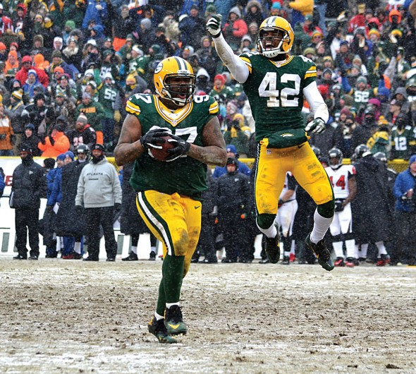 Packers safety Morgan Burnett whoops it up after Johnny Jolly recovered a second half against the Atlanta Falcons Sunday. Jim Oxley photograph