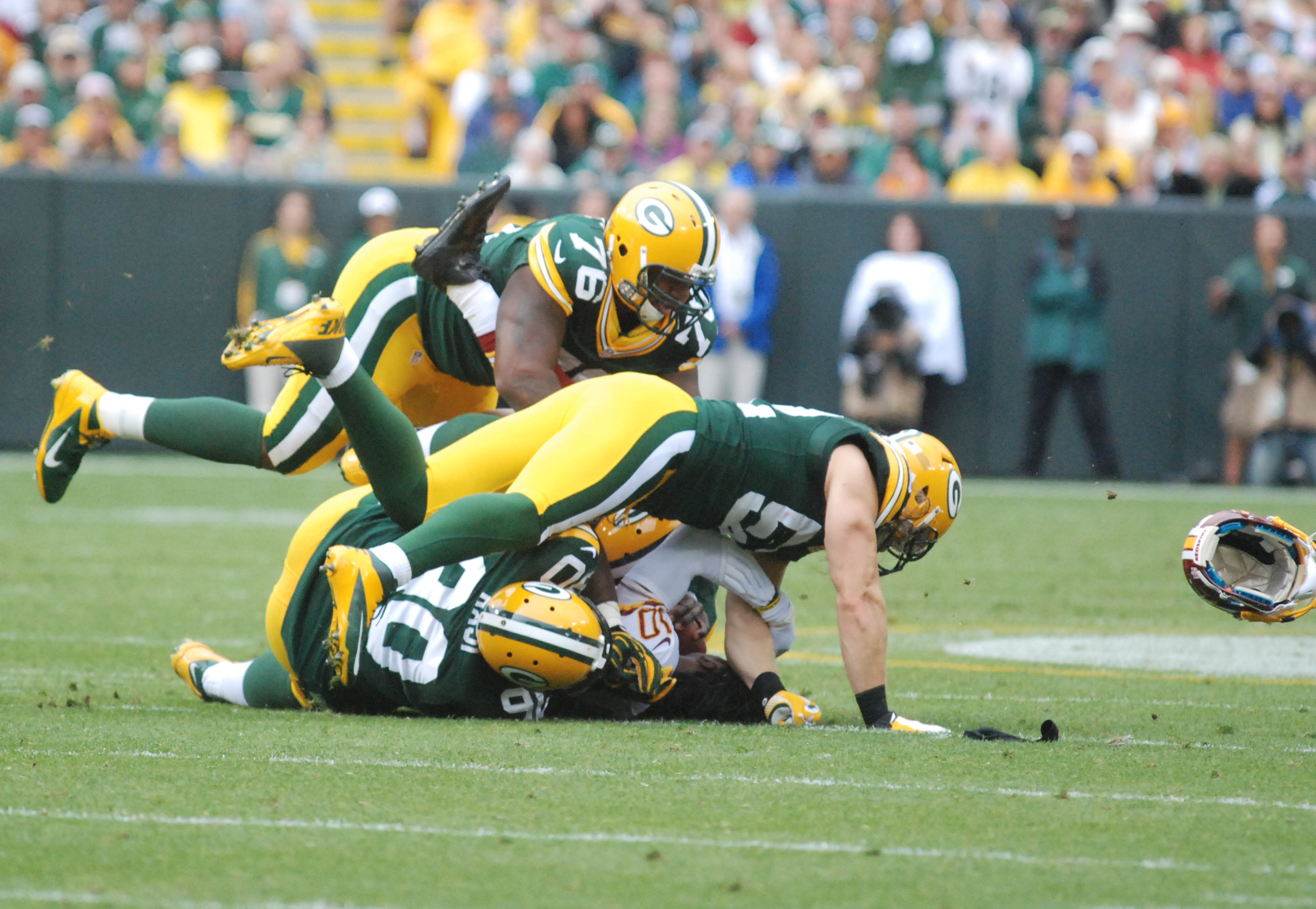 Remember when the Green Bay Packers actually laid the wood on players? Brian Jopek photograph