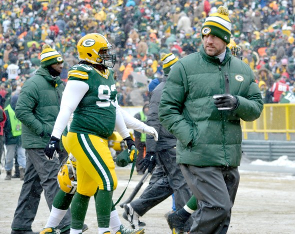 We will most likely see Aaron Rodgers once again out of uniform when Sunday rolls around ... saving a pre-Christmas miracle. Jim Oxley photograph