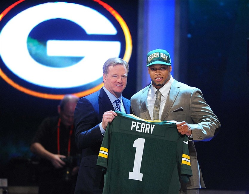 Apr 26, 2012; New York, NY, USA; NFL commissioner Roger Goodell introduces defensive end Nick Perry (Southern Cal) as the 28th overall pick by the Green Bay Packers in the 2012 NFL Draft at Radio City Music Hall. Mandatory Credit: James Lang-USA TODAY Sports