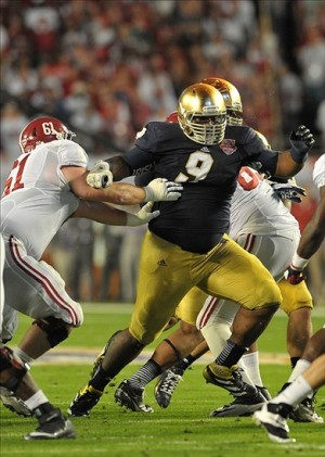Notre Dame Fighting Irish defensive lineman Louis Nix III (9) fights off a block by Alabama Crimson Tide offensive linesman Anthony Steen (61). Matt Cashore-USA TODAY Sports