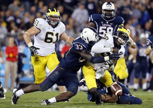 Connecticut Huskies linebacker Yawin Smallwood (33) forces the fumble as he sacks Michigan Wolverines quarterback Devin Gardner (98). David Butler II-USA TODAY Sports photograph