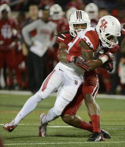 Nov 16, 2013; Louisville, KY, USA; Louisville Cardinals safety Calvin Pryor (25) tackles Houston Cougars running back Ryan Jackson (22) during the second quarter at Papa John