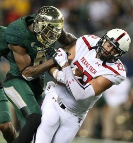 Nov 16, 2013; Arlington, TX, USA; Texas Tech Red Raiders tight end Jace Amaro (22) catches a pass in the second quarter while hit by Baylor Bears safety Ahmad Dixon (6) at AT