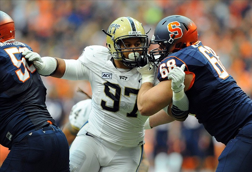 Pittsburgh Panthers defensive lineman Aaron Donald (97) is blocked by Syracuse Orange guard Nick Robinson (68) during the second quarter at the Carrier Dome. Mandatory Credit: Rich Barnes-USA TODAY Sports