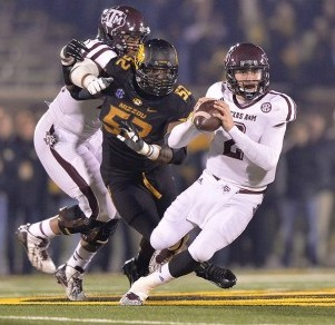 Texas A&M quarterback Johnny Manziel (2) is pressured by Missouri defensive end Michael Sam (52). Peter G. Aiken-USA TODAY Sports photograph