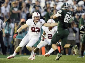 Jan 1, 2014; Pasadena, CA, USA; Michigan State Spartans tight end Josiah Price (82) runs against Stanford Cardinal linebacker Trent Murphy (93) for a nine-yard gain during the second half at the Rose Bowl. Mandatory Credit: Robert Hanashiro-USA TODAY Sports