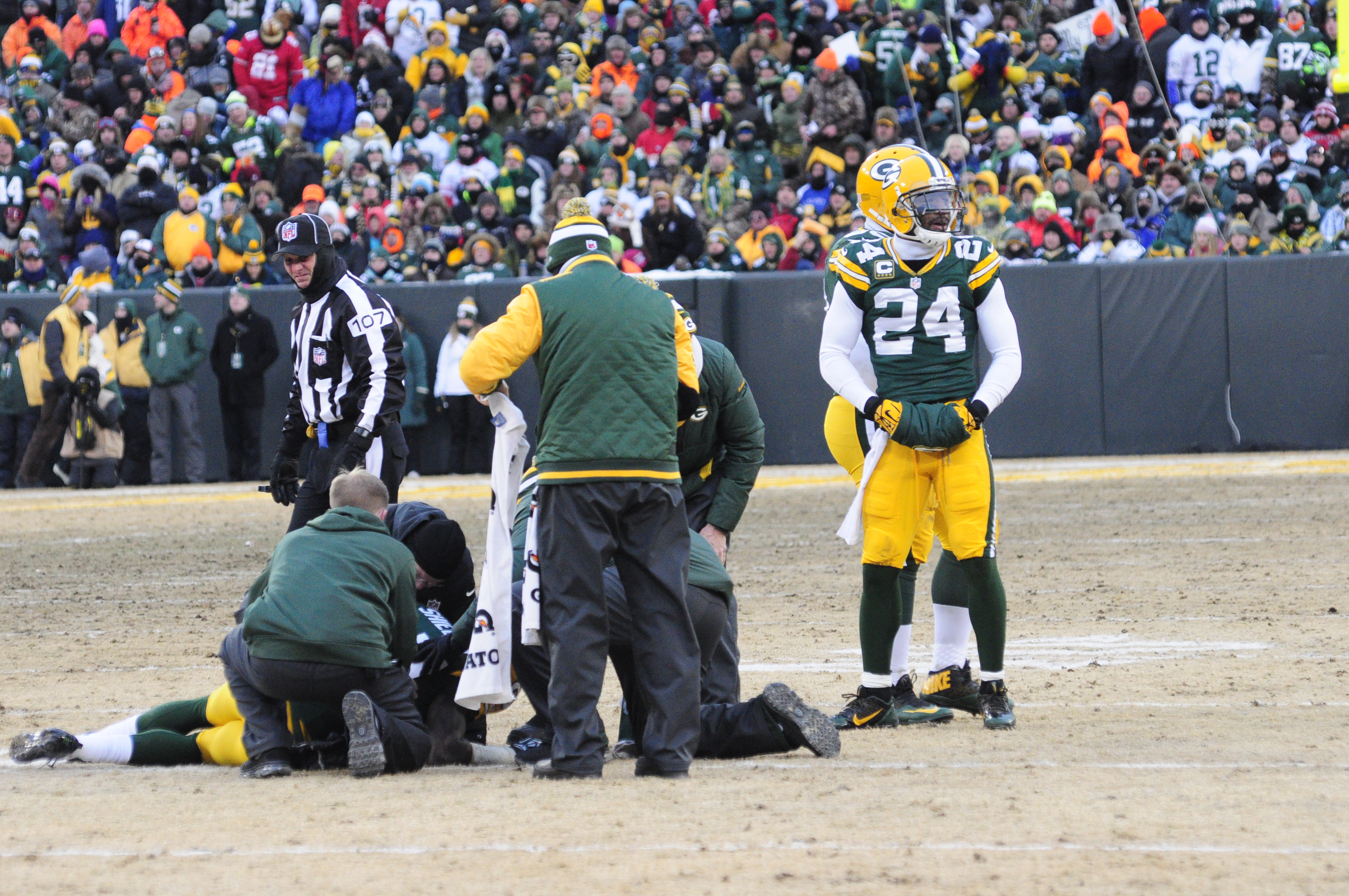 Sam Shields is surrounded by Packers personnel after he went down with a knee injury early on in the Packers vs. 49ers Wildcard Playoff game. His injury will have no effect on his next contract and only underscored just how valuable he is to the team. Raymond T. Rivard photograph