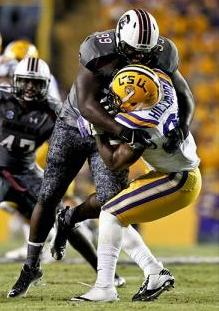 South Carolina Gamecocks defensive tackle Kelcy Quarles (99) tackles LSU Tigers running back Kenny Hilliard (27). Derick E. Hingle-USA TODAY Sports