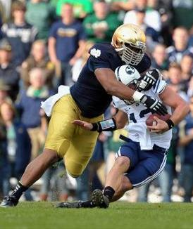 Notre Dame Fighting Irish defensive end Stephon Tuitt (7) sacks BYU Cougars quarterback Riley Nelson (13). Matt Cashore-USA TODAY Sports