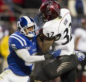 Cincinnati Bearcats running back George Winn (32) runs into Duke Blue Devils cornerback Ross Cockrell (6). Jeremy Brevard-USA TODAY Sports