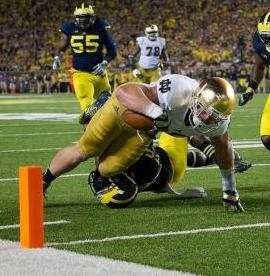 Notre Dame Fighting Irish tight end Troy Niklas (85) dives into the end zone for a touchdown as Michigan Wolverines safety Jarrod Wilson (22) defends. Matt Cashore-USA TODAY Sports