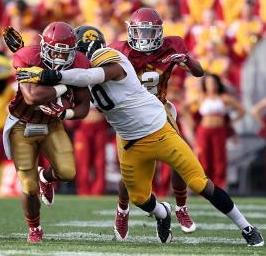 Iowa State Cyclones running back James White (8) gets hit by Iowa Hawkeyes linebacker Christian Kirksey (20). Reese Strickland-US PRESSWIRE