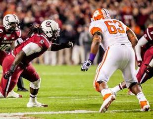 Nov 30, 2013; Columbia, SC, USA; South Carolina Gamecocks defensive end Jadeveon Clowney (7) rushes the quarterback against Clemson Tigers guard Tyler Shatley (62) in the second quarter at Williams-Brice Stadium. Mandatory Credit: Jeff Blake-USA TODAY Sports