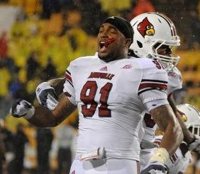 Louisville Cardinals defensive end Marcus Smith (91) celebrates their last defensive stand against the Southern Miss Golden Eagles. Chuck Cook - USA TODAY Sports