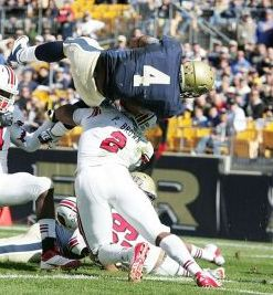 Pittsburgh Panthers running back Rushel Shell (4) gets flipped by Louisville Cardinals linebacker Preston Brown (2). Charles LeClaire-USA TODAY Sports