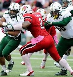 October 20, 2012; Louisville, KY USA; South Florida Bulls running back Demetris Murray (21) runs the ball against Louisville Cardinals linebacker Preston Brown (2). Jamie Rhodes-USA TODAY Sports