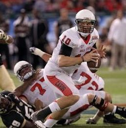 December 21, 2012; St. Petersburg, FL, USA; Ball State Cardinals quarterback Keith Wenning (10) runs out of the pocket against the UCF Knights. Kim Klement-USA TODAY Sports