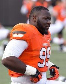 Oklahoma State Cowboys defensive tackle Calvin Barnett (99). Richard Rowe-USA TODAY Sports