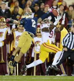 Southern California Trojans receiver Marqise Lee (9) is defended by Notre Dame Fighting Irish cornerback Bennett Jackson (2). Kirby Lee-USA TODAY Sports