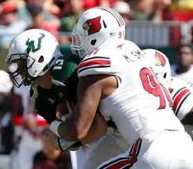 Louisville Cardinals defensive end Marcus Smith (91) sacks South Florida Bulls quarterback Bobby Eveld (13). Kim Klement-USA TODAY Sports