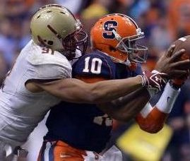 Boston College Eagles defensive end Kasim Edebali (91) wrestles Syracuse Orange quarterback Terrel Hunt (10) for the ball after he blocked a pass attempt. Mark Konezny-USA TODAY Sports
