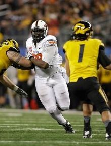 Oklahoma State Cowboys defensive tackle Calvin Barnett (99) rushes Missouri Tigers quarterback James Franklin (1). Tim Heitman-USA TODAY Sports
