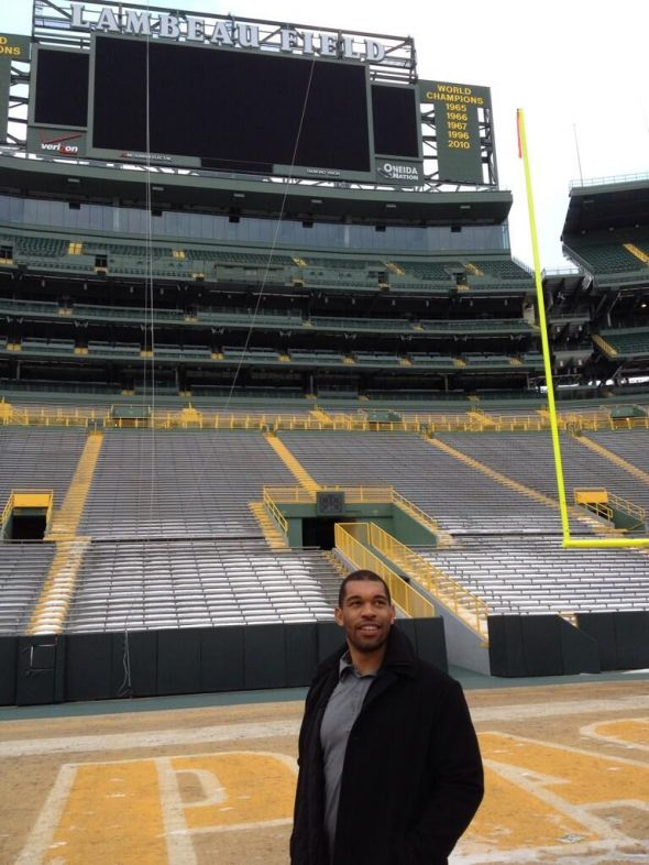 Julius Peppers this morning on the Lambeau Field turf moments after signing a three-year contract with the Green Bay Packers. Courtesy of Julius Peppers' agent posted on Twitter.