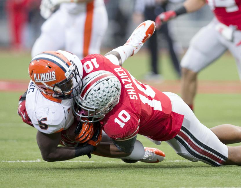 Ohio State Buckeyes linebacker Ryan Shazier (10) tackles Illinois Fighting Illini running back Donovonn Young (5). Greg Bartram-USA TODAY Sports