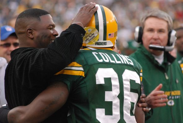 Nick Collins, a second-rounder, has been one of Ted Thompson's best picks. He's congratulated here by another defensive back from another Packers championship team, LeRoy Butler. Raymond T. Rivard photograph