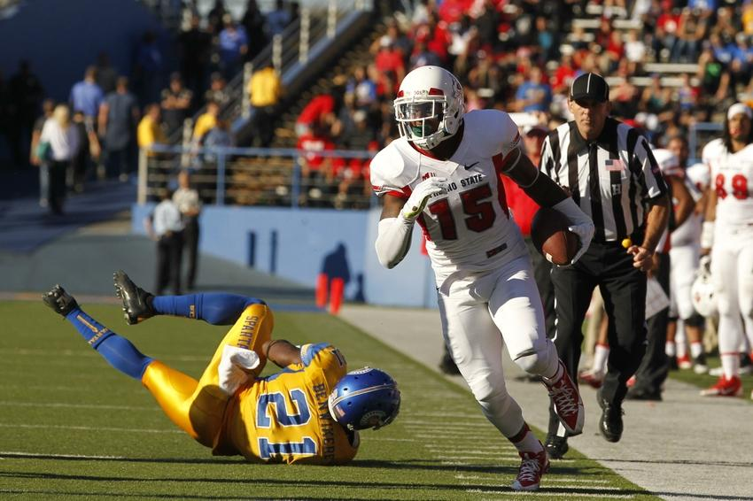 Nov 29, 2013; San Jose, CA, USA; Fresno State Bulldogs wide receiver Davante Adams (15) runs past San Jose State Spartans cornerback Bene Benwikere (21) after making a catch in the second quarter at Spartan Stadium. The Spartans defeated the Bulldogs 62-52. Mandatory Credit: Cary Edmondson-USA TODAY Sports