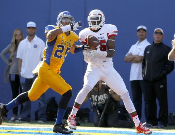 Nov 29, 2013; San Jose, CA, USA; Fresno State Bulldogs wide receiver Davante Adams (15) catches a touchdown pass in front of San Jose State Spartans cornerback Akeem King (25) in the first quarter at Spartan Stadium. Mandatory Credit: Cary Edmondson-USA TODAY Sports