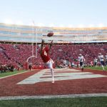 Wisconsin Badgers wide receiver Jared Abbrederis (4) reaches for a pass during the game against the Brigham Young Cougars at Camp Randall Stadium. Wisconsin won 27-17. Jeff Hanisch-USA TODAY Sports