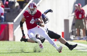 Wisconsin Badgers wide receiver Jared Abbrederis (4) rushes with the football after catching a pass. Jeff Hanisch-USA TODAY Sports