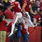 Jared Abbrederis (4) and Jordan Fredrick (9) celebrate a touchdown during the second quarter against the Indiana Hoosiers at Camp Randall Stadium. Jeff Hanisch-USA TODAY Sports