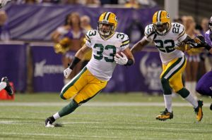Green Bay Packers cornerback Micah Hyde (33) returns a punt for a touchdown. Brace Hemmelgarn-USA TODAY Sports