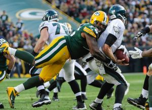 Green Bay Packers defensive end Mike Daniels sacks Philadelphia Eagles quarterback Nick Foles (9) in the fourth quarter at Lambeau Field. The Eagles won 27-13. Benny Sieu-USA TODAY Sports photograph