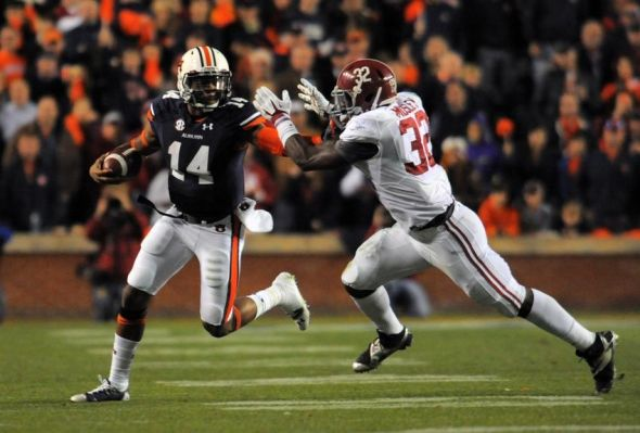 Nov 30, 2013; Auburn, AL, USA; Auburn Tigers quarterback Nick Marshall (14) runs against Alabama Crimson Tide linebacker C.J. Mosley (32) during the second half at Jordan Hare Stadium. Mandatory Credit: Shanna Lockwood-USA TODAY Sports