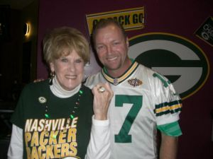 Former Packers' punter Craig Hentrich shows Club member Beverly his Super Bowl XXXI ring.
