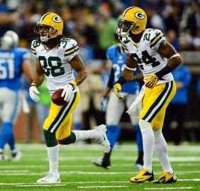 Nov 28, 2013; Detroit, MI, USA; Green Bay Packers cornerback Tramon Williams (38) celebrates after intercepting a pass during the second quarter of a NFL football game against the Detroit Lions on Thanksgiving at Ford Field. Mandatory Credit: Andrew Weber-USA TODAY Sports