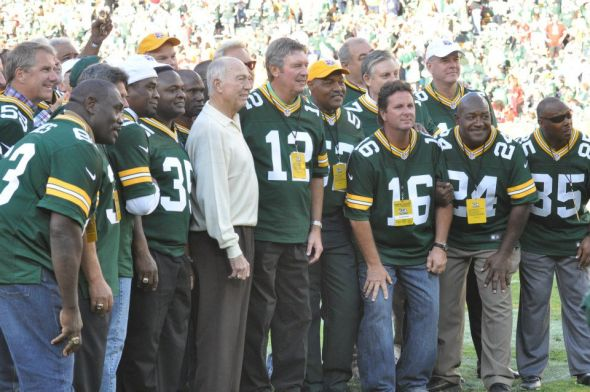John Anderson (far left, #59), joins his 1982 teammates for a group photograph during halftime of the Packers' 2012 home opener. Raymond T. Rivard photograph