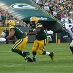 Eddie Lacy finds a hole against the Oakland Raiders. Jim Oxley photograph