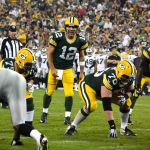 Aaron Rodgers gets the offense set at the line of scrimmage. Jim Oxley photograph
