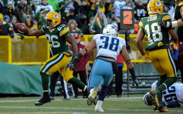 Dec 23, 2012; Green Bay, WI, USA; Green Bay Packers running back DuJuan Harris (26) runs past Tennessee Titans safety Al Afalava (38) to score a touchdown at Lambeau Field. Mandatory Credit: Benny Sieu-USA TODAY Sports