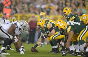 Green Bay Packers center Corey Linsley readies for the snap of the ball to quarterback Matt Flynn against the Oakland Raiders at Lambeau Field. Kirby Lee-USA TODAY Sports photograph