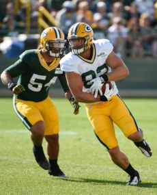 Green Bay Packer tight end Ryan Taylor (82) runs past linebacker Carl Bradford as the Packers train their bodies and minds in camp. Benny Sieu-USA TODAY Sports