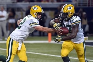 Packers quarterback Aaron Rodgers hands the ball off to running back Eddie Lacy. Jasen Vinlove-USA TODAY Sports