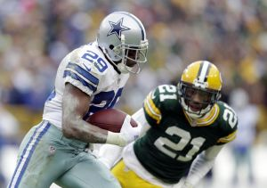 Cowboys running back DeMarco Murray runs past Green Bay Packers free safety Ha Ha Clinton-Dix (21) in the fourth quarter in the 2014 NFC Divisional playoff football game at Lambeau Field. Jeff Hanisch-USA TODAY Sports photograph