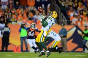 Nov 1, 2015; Denver, CO, USA; Green Bay Packers strong safety Micah Hyde (33) returns a punted football in the first quarter against the Denver Broncos at Sports Authority Field at Mile High. Mandatory Credit: Ron Chenoy-USA TODAY Sports