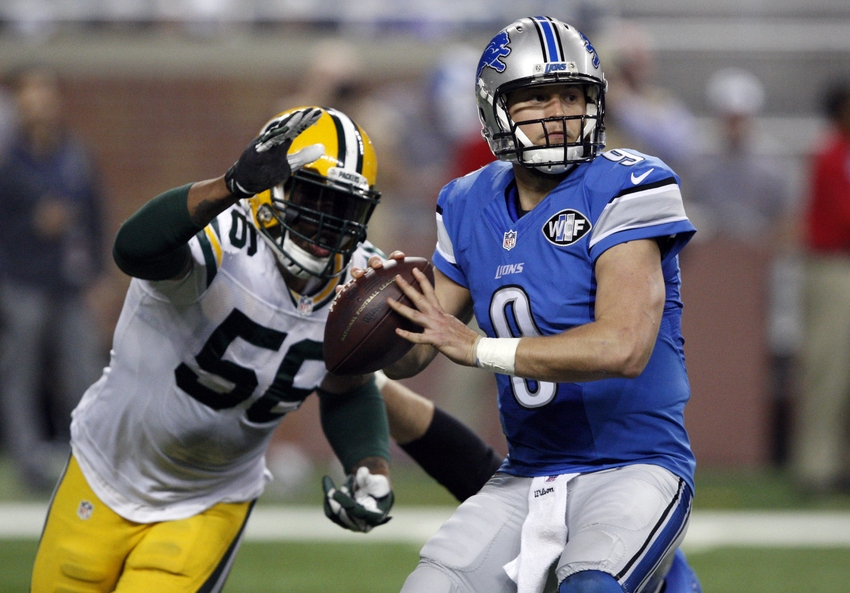 Green Bay Packers outside linebacker Julius Peppers strips the ball away from Detroit Lions quarterback Matthew Stafford. Raj Mehta-USA TODAY Sports